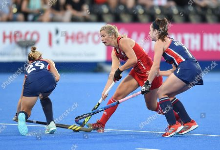 Erin Matson and Alyssa Manley of USA collide with Sophie Bray of England