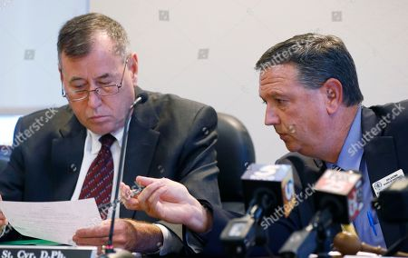 Kyle Whitehead, Mark St. Cyr. Kyle Whitehead, right, president of the Oklahoma Board of Pharmacy, talks with Mark St. Cyr, left, vice president, during a board meeting in Oklahoma City, . The Board voted unanimously to fire Chelsea Church, its executive director, after state investigators confirmed she is the target of a bribery probe involving text messages exchanged with a top lawyer involved in writing the state's new medical marijuana rules