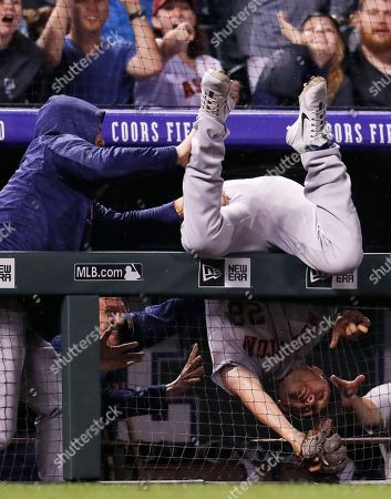 J D Davis, r m. Houston Astros third baseman J.D. Davis ends up over the dugout railing after catching a pop foul off the bat of Colorado Rockies' Nolan Arenado during the seventh inning of a baseball game, in Denver. With the bases loaded, Colorado Rockies' Raimel Tapia scored the tying run. The Rockies won 3-2