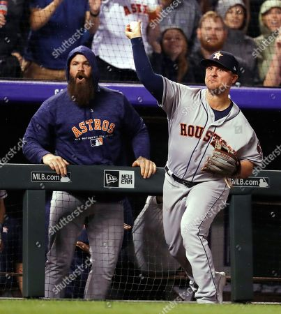J D Davis, r m. After catching a pop foul by falling over the dugout rail, Houston Astros third baseman J.D. Davis throws to home plate as Colorado Rockies' Raimel Tapia scores the tying run during the seventh inning of a baseball game, in Denver. The Rockies won 3-2