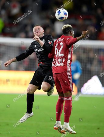 D.C. United forward Wayne Rooney (9) competes for the ball against New York Red Bulls defender Michael Amir Murillo (62) during the second half of an MLS soccer match, in Washington. The Red Bulls won 1-0