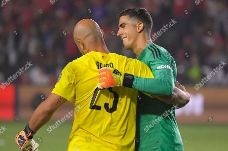 Manchester United goalkeeper Joel Pereira, right, is congratulated by AC Milan goalkeeper Pepe Reina after Manchester United won a penalty shootout in an International Champions Cup tournament soccer match, in Carson, Calif. Manchester United won on a 9-8 penalty shootout following a 1-1 tie in regulation