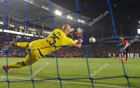 AC Milan goalkeeper Pepe Reina, left, stops a shot by Manchester United midfielder Scott McTominay during a penalty shootout in an International Champions Cup tournament soccer match, in Carson, Calif. Manchester United won on a 9-8 penalty shootout following a 1-1 tie in regulation