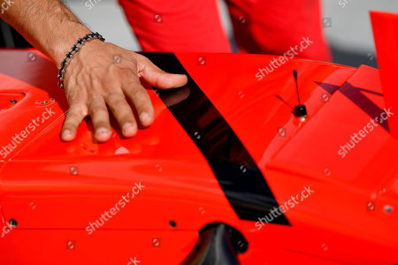 A black band is attached to a Ferrari car in commemoration to former CEO of Fiat Chrysler Automobiles (FCA) and Ferrari Sergio Marchionne who passed away on 25 July in the pit lane of  the Hungaroring circuit in Mogyorod, 23 kms north-east of Budapest, Hungary, 26 July 2018, three days ahead of the Formula One Hungarian Grand Prix.