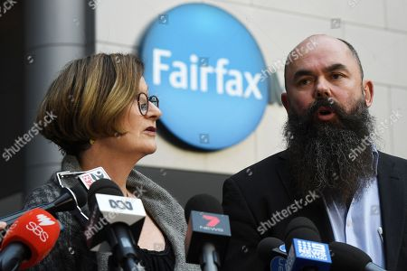 Stock Photo of Sydney Morning Herald investigative journalist Kate McClymont is joined by MEAA Federal President Marcus Strom as they speaks outside the Fairfax Media offices in Sydney, Australia, 26 July 2018. Fairfax Media CEO Greg Hywood spoke to Fairfax staff regarding the merger announcement between Fairfax and Nine.