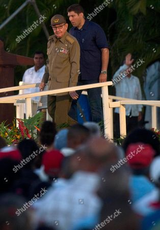 Raul Castro, Guillermo Rodriguez Castro. Flanked by his personal assistant and grandson Guillermo Rodriguez Castro, Cuba's former President Raul Castro attends an event celebrating Revolution Day, in Santiago, Cuba, . Cuba marks the 65th anniversary of the July 26, 1953 rebel attack led by Fidel and Raul Castro on the Moncada military barracks. The attack is considered the beginning of Fidel Castro's revolution that culminated with dictator Fulgencio Batista's ouster