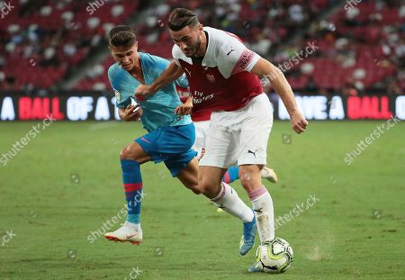 Atletico Madrid's Alberto Rodriguez (L) in action against Arsenal's Sead Kolasinac during the International Champions Cup match between Arsenal FC and Atletico Madrid at the National Stadium in Singapore, 26 July 2018.
