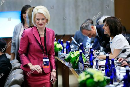 U.S. Ambassador to the Holy See Callista Gingrich, left, arrives at the first-ever Ministerial to Advance Religious Freedom at the State Department in Washington