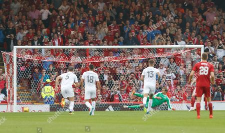 Gary Mackay-Steven of Aberdeen shoots past Burnley's substitute goalkeeper Anders Lindegaard from the penalty spot to give them a 1-0 lead