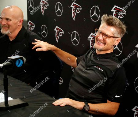Thomas Dimitroff Dan Quinn. Atlanta Falcons general manager Thomas Dimitroff, right, and head football coach Dan Quinn laugh during a new conference after it was announced the team had reached an agreement with receiver Julio Jones, in Flowery Branch, Ga