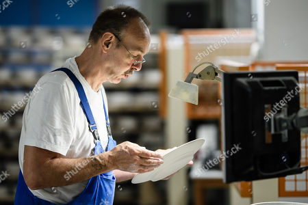 Staff worker Andreas Kessler checks a plate during quality control at the Royal Porcelain Factory 'Koenigliche Porzellan-Manufaktur' (KPM) in Berlin, Germany, 26 July 2018. The name Royal Porcelain Factory 'Koenigliche Porzellan-Manufaktur' (KPM) exists since 1763, when King Frederick II of Prussia took over the company from a businessman. Nowadays the company is run by Berlin banker Joerg Woltmann.