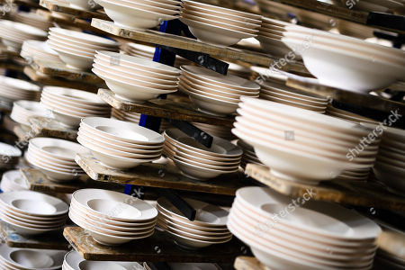 Soup bowls stand on planks at the Royal Porcelain Factory 'Koenigliche Porzellan-Manufaktur' (KPM) in Berlin, Germany, 26 July 2018. The name Royal Porcelain Factory 'Koenigliche Porzellan-Manufaktur' (KPM) exists since 1763, when King Frederick II of Prussia took over the company from a businessman. Nowadays the company is run by Berlin banker Joerg Woltmann.