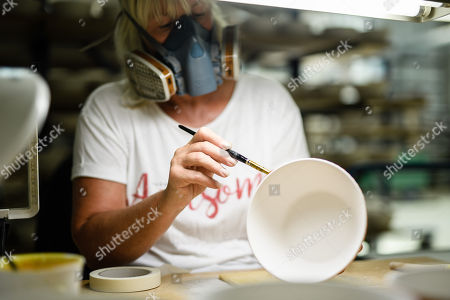 Staff worker Heike Rossmeisl puts on screen printing lacquer on a bowl at the Royal Porcelain Factory 'Koenigliche Porzellan-Manufaktur' (KPM) in Berlin, Germany, 26 July 2018. The name Royal Porcelain Factory 'Koenigliche Porzellan-Manufaktur' (KPM) exists since 1763, when King Frederick II of Prussia took over the company from a businessman. Nowadays the company is run by Berlin banker Joerg Woltmann.