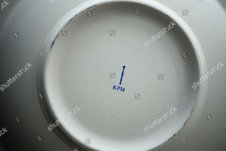 The KPM logo on a plate at the Royal Porcelain Factory 'Koenigliche Porzellan-Manufaktur' (KPM) in Berlin, Germany, 26 July 2018. The name Royal Porcelain Factory 'Koenigliche Porzellan-Manufaktur' (KPM) exists since 1763, when King Frederick II of Prussia took over the company from a businessman. Nowadays the company is run by Berlin banker Joerg Woltmann.