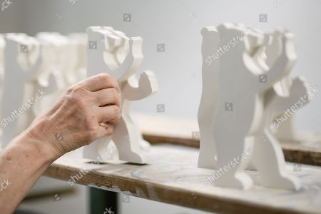 Staff worker Monika Fekih grabs a porcelain Berlin Bear at the Royal Porcelain Factory 'Koenigliche Porzellan-Manufaktur' (KPM) in Berlin, Germany, 26 July 2018. The name Royal Porcelain Factory 'Koenigliche Porzellan-Manufaktur' (KPM) exists since 1763, when King Frederick II of Prussia took over the company from a businessman. Nowadays the company is run by Berlin banker Joerg Woltmann.
