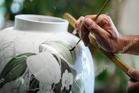 Staff worker Hagen Stolpmann paints a vase at the Royal Porcelain Factory 'Koenigliche Porzellan-Manufaktur' (KPM) in Berlin, Germany, 26 July 2018. The name Royal Porcelain Factory 'Koenigliche Porzellan-Manufaktur' (KPM) exists since 1763, when King Frederick II of Prussia took over the company from a businessman. Nowadays the company is run by Berlin banker Joerg Woltmann.
