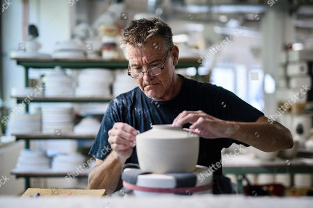 Staff worker Frank Luebeck works on the edgey of a  vase at the Royal Porcelain Factory 'Koenigliche Porzellan-Manufaktur' (KPM) in Berlin, Germany, 26 July 2018. The name Royal Porcelain Factory 'Koenigliche Porzellan-Manufaktur' (KPM) exists since 1763, when King Frederick II of Prussia took over the company from a businessman. Nowadays the company is run by Berlin banker Joerg Woltmann.