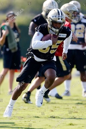 New Orleans Saints running back Shane Vereen runs with the ball during NFL football practice in Metairie, La