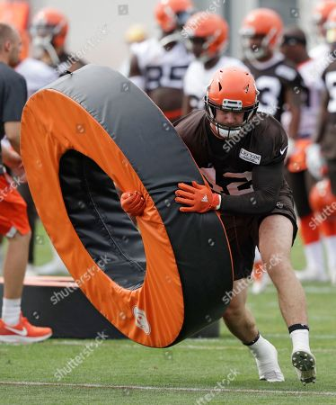 Cleveland Browns linebacker Justin Currie runs drills during NFL football training camp, in Berea, Ohio