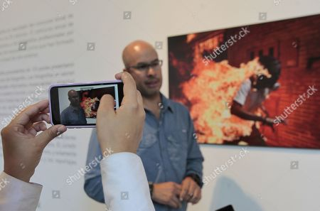 Venezuelan photojournalist Ronaldo Schemidt speaks during an interview in Mexico City, Mexico, 26 July 2018. Schemidt, won the World Press Photo 2017 for an image of a demonstrator engulfed in fire at a protest against the country?s president, Nicolas Maduro.The World Press Photo exhibition which travels around the world, opened at the Franz Mayer Museum.