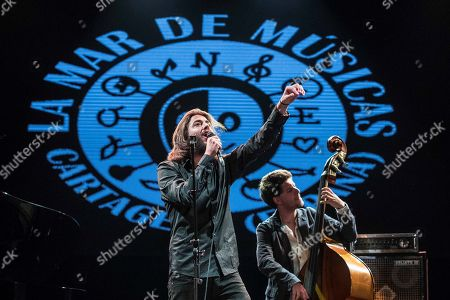 Portuguese singer Salvador Sobral (L), winner of Eurovision 2017 contest, performs on stage during his 'La Mar de Musicas' Festival concert played at the Cartagena's Torres Park in Murcia, southeastern Spain, 26 July 2018.
