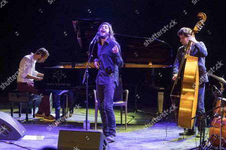 Portuguese singer Salvador Sobral (C), winner of Eurovision 2017 contest, performs on stage during his 'La Mar de Musicas' Festival concert played at the Cartagena's Torres Park in Murcia, southeastern spain, 26 July 2018.
