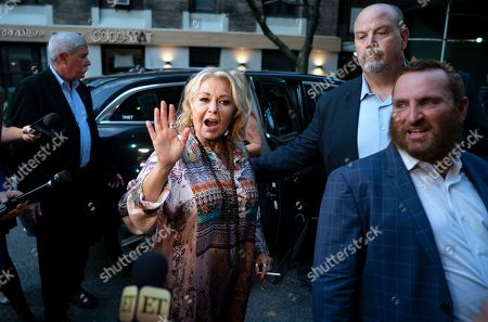 Comedian and actress Rosanne Barr, center, arrives to take part in a special event and podcast taping with Rabbi Shmuley Boteach, right, at Stand Up NY, in New York