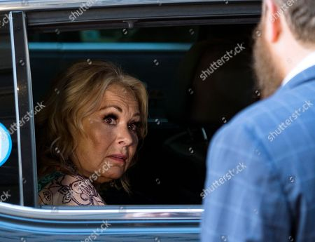 Comedian and actress Roseanne Barr arrives to take part in a special event and podcast taping with Rabbi Shmuley Boteach, right, at Stand Up NY, in New York