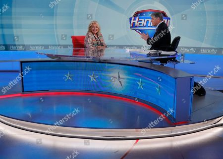 "Fox News talk show host Sean Hannity, right, interviews Roseanne Barr during a taping of his show, in New York. Roseanne Barr will appear on on the Fox News show ""Hannity"" on Thursday at 9 p.m. EDT for the first time since she was fired from ABC and her namesake show was canceled. ABC canceled its successful reboot of ""Roseanne"" in May following the star's racist tweet likening former Obama adviser Valerie Jarrett to a cross between the Muslim Brotherhood and a ""Planet of the Apes"" actor"