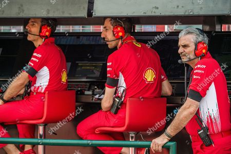 Ferrari team principal Maurizio Arrivabene, right, and team members wear black armbands, after the death of former Ferrari president Sergio Marchionne, as they stand at pits  during the second free practice session of the Hungarian Formula One Grand Prix at the Hungaroring circuit, in Mogyorod, north-east of Budapest, Hungary, 27 July 2018. The Hungarian Formula One Grand Prix will take place on 29 July.