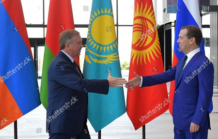 Stock Photo of Russian Prime Minister Dmitry Medvedev (R) shakes hands with Belarus Prime Minister Andrei Kobyakov (L) ahead of a session of the Eurasian Economic Union (EAEU) Intergovernmental Council in St. Petersburg, Russia, 27 July 2018. Prime Ministers of Russia, Armenia, Belarus, Kazakhstan and Kyrgyzstan meet in St.Petersburg to discuss issues of EAEU member-states interaction.
