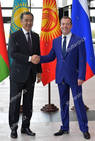 Stock Photo of Russian Prime Minister Dmitry Medvedev (R) shakes hands with Kazakhstan's Prime Minister Bakhytzhan Sagintayev (L) ahead of a session of the Eurasian Economic Union (EAEU) Intergovernmental Council in St. Petersburg, Russia, 27 July 2018. Prime Ministers of Russia, Armenia, Belarus, Kazakhstan and Kyrgyzstan meet in St.Petersburg to discuss issues of EAEU member-states interaction.