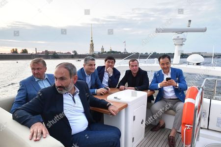 Armenian Prime Minister Nikol Pashinyan (front), Belarus Prime Minister Andrei Kobyakov (back L), Eurasian Economic Commission Board Chairman Tigran Sargsyan (back 2-L), Kyrgyz Prime Minister Mukhammedkaliy Abylgaziyev (back C), Russian Prime Minister Dmitry Medvedev (back 2-R) and Kazakhstan's Prime Minister Bakhytzhan Sagintayev (back R) during an informal meeting of the Eurasian Economic Union (EAEU) Intergovernmental Council in St. Petersburg, Russia, 27 July 2018. Prime Ministers of Russia, Armenia, Belarus, Kazakhstan and Kyrgyzstan meet in St.Petersburg to discuss issues of EAEU member-states interaction.