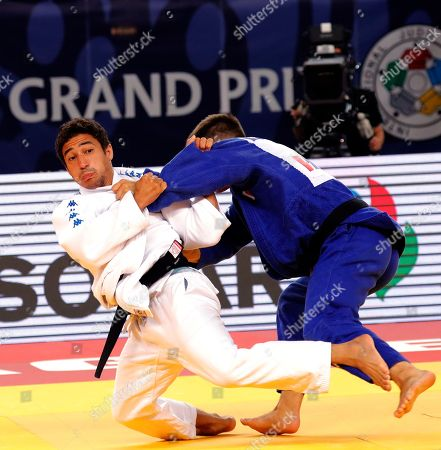 Ashley Mckenzie of Great Britain (white) fights Andrea Carlino (blue) of Italy in the men's Judo - 60 kg bronze medal match at the Judo World Cup in Zagreb, Croatia, 27 July 2018.
