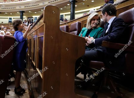 Spanish People's Party (PP) leader, Pablo Casado (R), in the presence of former Spanish deputy Prime Minister and PP member Soraya Saenz de Santamaria (L), chats with PP member Fatima Banez during a session to vote the fiscal consolidation path for 2019, at the Lower Hose of the Spanish Parliament in Madrid, Spain, 27 July 2018.