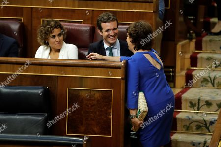 Spanish People's Party (PP) leader, Pablo Casado (C), in the presence of PP's spokeswoman at Parliament, Dolors Monserrat (L), chats with former Spanish deputy Prime Minister and PP member Soraya Saenz de Santamaria (R) during a session to vote the fiscal consolidation path for 2019, at the Lower Hose of the Spanish Parliament in Madrid, Spain, 27 July 2018.