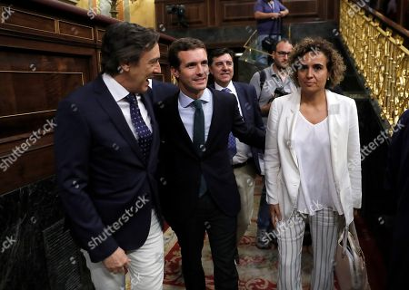 Spanish People's Party (PP) leader, Pablo Casado (C), next to PP's spokeswoman at Parliament Dolors Montserrat (R) and PP member Rafael Hernando (L) during a session to vote the fiscal consolidation path for 2019, at the Lower Hose of the Spanish Parliament in Madrid, Spain, 27 July 2018.