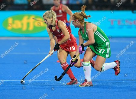 Sophie Bray of England shields the ball from Zoe Wilson of Ireland