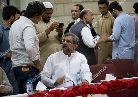 Shahid Khaqan Abbasi. Former prime minister of Pakistan Shahid Khan Abbasi, center, talks to a visitor during the All Parties Conference (APC) in Islamabad, Pakistan, . APC has rejected the results of the July 25 general election result. With Pakistani election officials declaring the party of Imran Khan to be the winner of parliamentary balloting, the former cricket star turned Friday to forming a coalition government, since the party did not get an outright majority