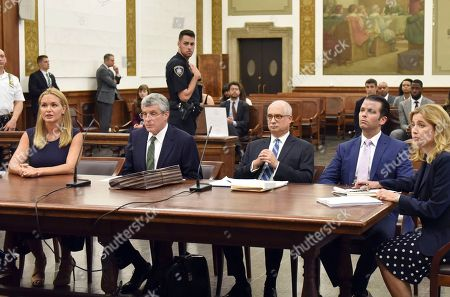 Stock Photo of Donald Trump Jnr., second from right, and Vanessa Haydon Trump, left, appear in court for a hearing in their divorce case in New York, Thursday, July 26, 2018. Vanessa Haydon Trump filed for divorce from Trump Jr. in March.