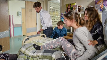 Stock Image of Ep 8227 Thursday 9th August 2018 - 1st Ep In the hospital, Debbie Dingle, as played by Charley Webb, meets Dom, as played by Finlay Sheard, one of Sarah Sugden's, as played by Katie Hill, friends on the ward. Later, everyone is shocked when Dom suddenly collapses, with Joe Tate, as played by Ned Porteous, Debbie Dingle, as played by Charley Webb.