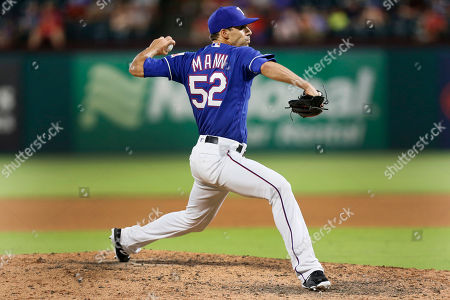 Texas Rangers relief pitcher Brandon Mann throws to the Oakland Athletics during the 7th inning of a baseball game, in Arlington, Texas