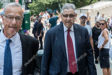 Former New York Assembly Speaker Sheldon Silver, right, arrives at federal court in New York, . Silver, the former New York Assembly speaker who brokered legislative deals for two decades before corruption charges abruptly ended his career, will be sentenced for a second time Friday