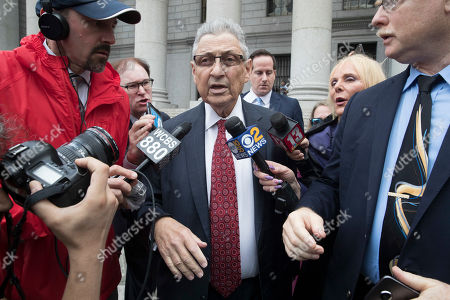 """Former New York Assembly Speaker Sheldon Silver, center, is surrounded by reporters as he leaves federal court in New York after his sentencing, . Silver, a former New York Assembly speaker who brokered legislative deals for two decades before criminal charges abruptly ended his career, was sentenced Friday to seven years in prison by a judge who said political corruption in the state """"has to stop"""