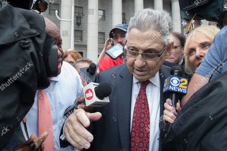 "Former New York Assembly Speaker Sheldon Silver is surrounded by reporters as he leaves federal court in New York after his sentencing, . Silver, a former New York Assembly speaker who brokered legislative deals for two decades before criminal charges abruptly ended his career, was sentenced Friday to seven years in prison by a judge who said political corruption in the state ""has to stop"