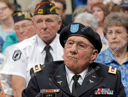 """Korean war veteran Lt. Col. Carl Lewis of Kearney, Neb., center, sits with other veterans during a ceremony on the 65th anniversary of the armistice, to honor veterans who served during the Korean War, in Lincoln, Neb., . President Donald Trump thanked North Korean leader Kim Jong Un on Friday for """"fulfilling a promise"""" to return the remains of U.S. soldiers missing from the Korean War, as a U.S. military plane made a rare trip into North Korea to retrieve 55 cases said to contain remains"""