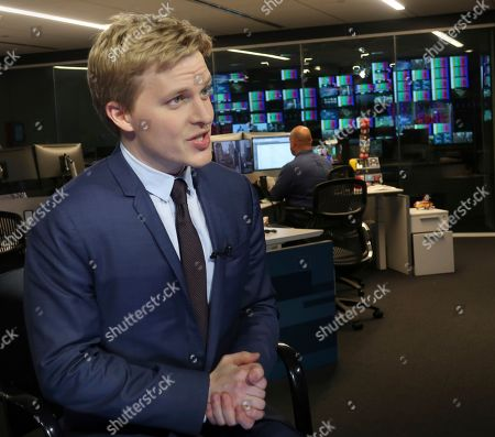 Ronan Farrow, a contributing writer for the New Yorker, speaks with reporters at Associated Press headquarters in New York, . Farrow, who wrote a Pulitzer Prize-winning story for the New Yorker on the sexual misconduct allegations against media mogul Harvey Weinstein, has written a similar story for the magazine on CBS Chief Executive Officer, Les Moonves
