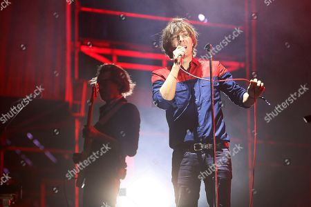 French band 'Phoenix' singer Thomas Mars (R) performs on stage during the Low Festival concert played in Benidorm, Alicante, eastern Spain, 27 July 2018.