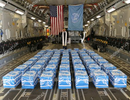 United Nations Command Chaplain U.S. Army Col. Sam Lee performs a blessing of sacrifice and remembrance on the 55 cases of remains believed to be U.S. servicemen killed during the Korean War and returned by North Korea at Osan Air Base in Pyeongtaek, South Korea