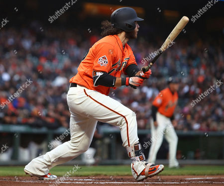 San Francisco Giants' Brandon Crawford watches his RBI double off Milwaukee Brewers' Chase Anderson in the second inning of a baseball game, in San Francisco